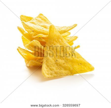 Corn nacho chips. Yellow tortilla chips isolated on white background.