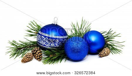 Christmas Decoration Blue Balls With Fir Cones And Fir Tree Branches Isolated On A White Background
