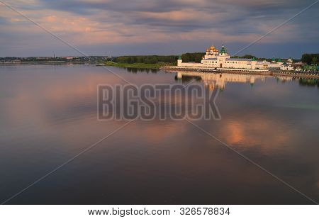 Holy Trinity Ipatiev Monastery At Dawn, View From The Bridge Over The Kostroma River On A Summer Mor