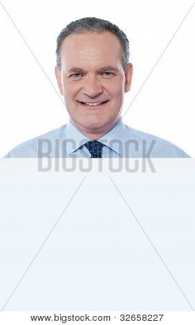 Senior Business Professiona Displaying Blank Ad
