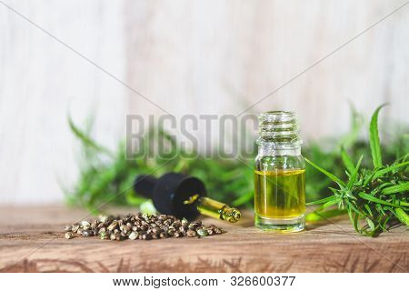 Cbd Oil Hemp Products, Medicinal Cannabis With Extract Oil In A Bottle. Medical Cannabis Concept