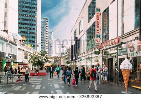 Stockholm, Sweden - June 28, 2019: Tourists People Walking In Famous Drottninggata Street. Drottning