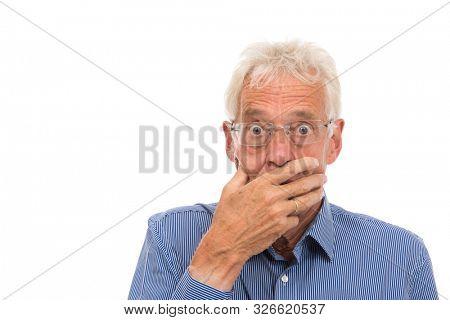 Portrait senior man in shock isolated against white background