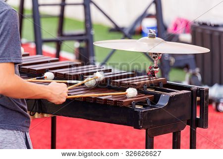 A Sideline Percussionist Performing At An Outdoors Rehearsal