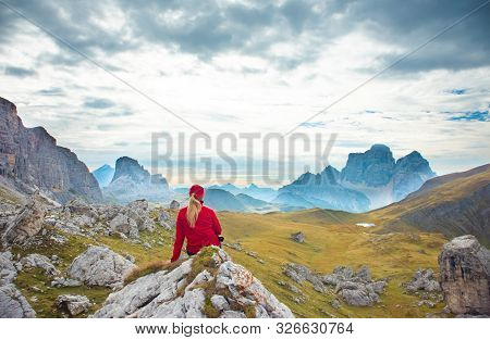 Sporty Young Woman Relaxing On Mountain Trail Marmolada, Dolomites Mountains, Italy. Sport, Success,