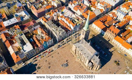 Pilsen / Czech Republic - September 9, 2019: Aerial view to The cathedral of St. Bartholomew. Gothic church located on the Main Square in Pilsen.  Spire height is 102.3 m. Beautiful European landmark.