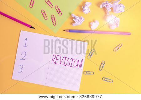 Word writing text Revision. Business concept for action of revising over someone like auditing or accounting Blank squared notebook pencils paper sheet crushed balls colored background. poster
