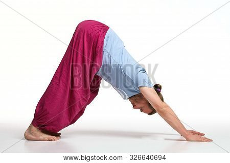 Bearded Longhair Man Practicing Yoga. Model Doing Exercises Isolated On White Background. Adho Mukha