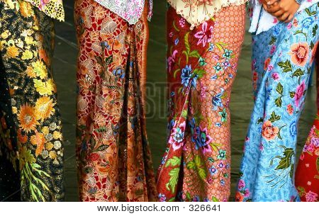 sarong kebaya, a traditional nyonya and malay dress in batik motifs. poster
