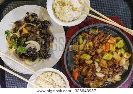 Asian Food, Roast Meat And Rice With Chopsticks In The Bowl, Vegetables And Mushroom, Top View. Gast