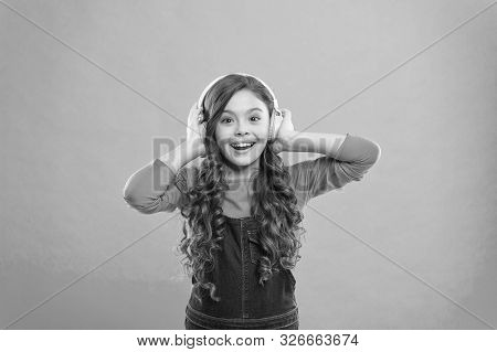 Feeling The Beauty Of The Song. Cute Small Child Listening To Song On Blue Background. Adorable Litt