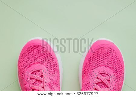 Kid S Sport Shoes. Isolated On Green Background With Clipping Path.pair Of Blue And White Sneakers O