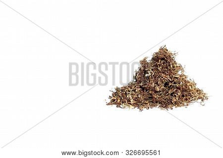 A Slide Of Brown Cigarette Tobacco Thinly Sliced Isolated On A White Background. The Concept Of The