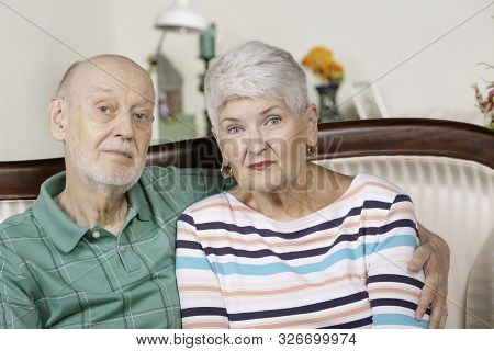 Worried Or Upset Senior Man And Woman At Home