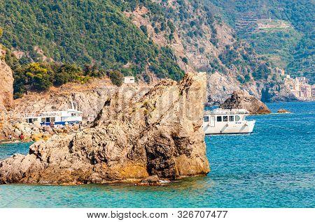 Monterosso Al Mare, Italy - September 02, 2019: Sea Yachts And Boats Traveling Near The Rocky Coastl