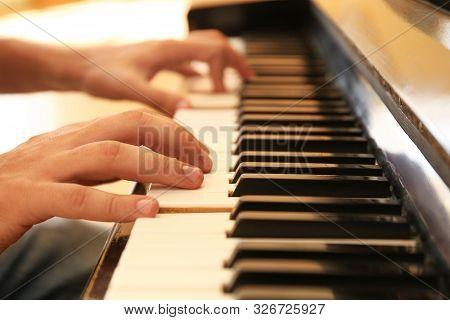 Man Playing Piano Indoors, Closeup. Music Lesson