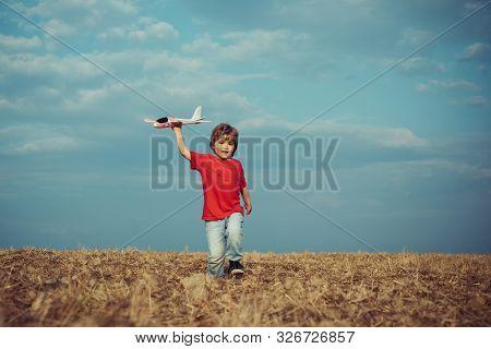 Childhood Memories. Active Leisure With Kids. Kid Pilot Having Fun On Meadow. Summer Leisure. Cheris