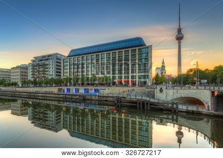 BERLIN, GERMANY - JUNE 15, 2017: Architecture of city center in Berlin at sunrise, Germany. Berlin is the capital and the largest city of Germany with a population of approximately 3.7 million people.