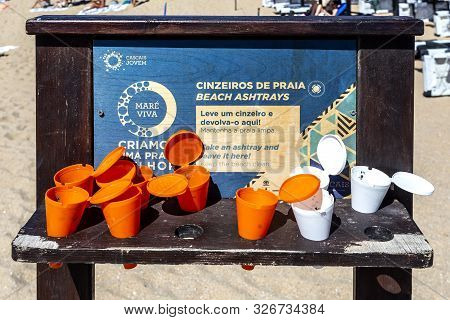 Cascais - August 14, 2019: View Of The Bilingual (portuguese And English) Ashtray Stand Installed In