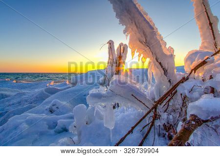 Ice Formations On The Coast Of Lake Michigan. Beautiful Sunset On The Coast Of Lake Michigan With Ic