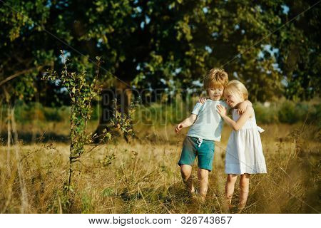 Child And Vegetables On The Farm. Summer At Countryside. Children Enjoy In Farm. Nature And Children