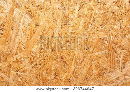 Close Up Osb Boards Are Made Of Brown Wood Chips Sanded Into A Wooden Background. Top View Of Osb Wo