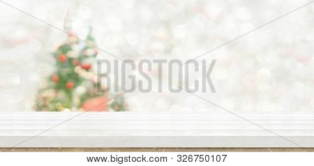 Empty White Wood Table Top With Abstract Warm Living Room Decor With Christmas Tree String Light Blu