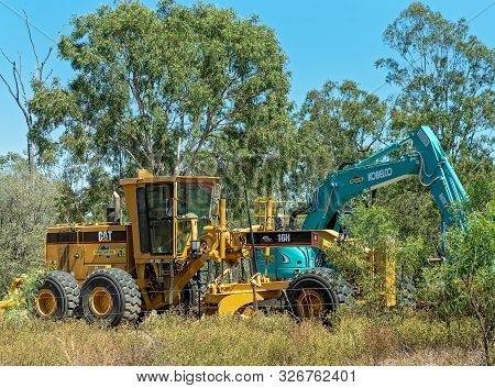 Nebo, Queensland, Australia - October 2019: Grader And Excavator Heavy Duty Earth Moving Machinery P