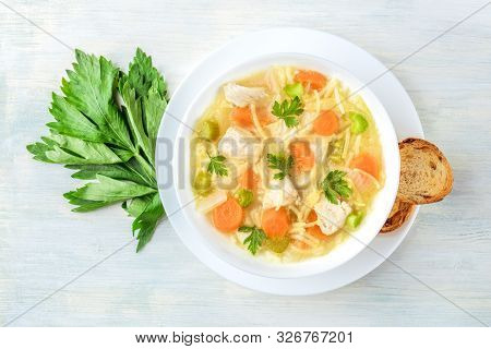 Chicken Noodle Soup, Shot From The Top With Toasted Bread