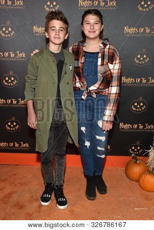 LOS ANGELES - OCT 02:  Parker Bates and Mackenzie Hancsicsak arrives for Nights of the Jack VIP Preview on October 02, 2019 in Calabasas, CA