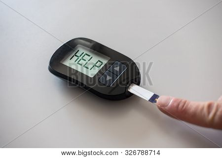 Glucometer Asks For Help After Measuring The Blood Sugar: Concept Of Hyperglycemia
