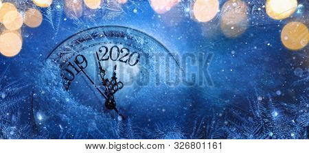 Happy New Years 2020. Winter Celebration With Dial Clock On Snow And Light