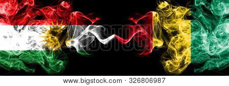 Kurdistan Vs Guinea, Guinean Smoke Flags Placed Side By Side. Thick Colored Silky Smoke Flags Of Kur