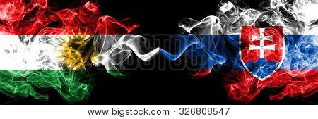Kurdistan Vs Slovakia, Slovakian Smoke Flags Placed Side By Side. Thick Colored Silky Smoke Flags Of