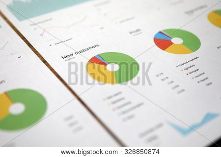 Close-up Of Print Papers With Colorful Diagrams, Graphs, Charts. Counting Document With Financial Fo