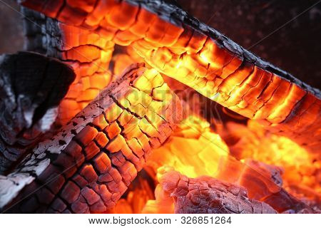 Close-up Of Burning Log In Bonfire. Large Orange Flame From Fire With Woods. Light And Ash From Wood