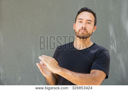 Satisfied Guy Applauding, Expressing Approval And Support. Front View Of Man In Casual Clapping Hand
