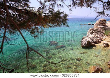 Dalmatia Adriatic Coast With Limestone Rocks. Croatia Coast Landscape. Beaches And Coast Of Mimice.