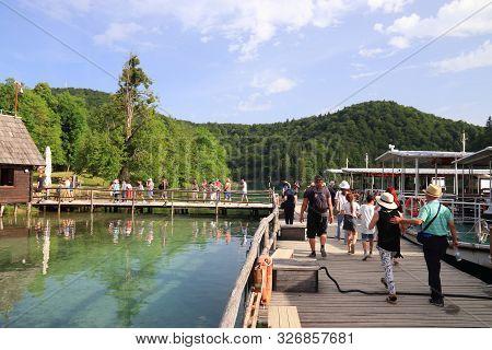 Plitvice, Croatia - June 15, 2019: People Visit Plitvice Lakes National Park (plitvicka Jezera) In C