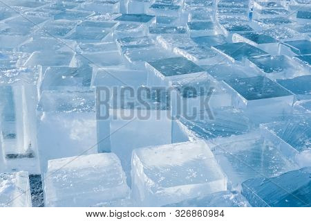 Ice Square Blocks In The Winter Background. The Texture Of The Ice In The Winter. Squares For Making