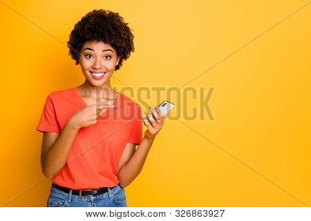Copyspace Photo Of Stylish Trendy Cheerful Cute Pretty Charming Girlfriend Pointing At Her Phone Hel