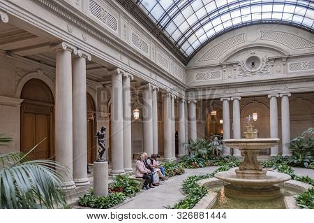 New York City - April 17, 2016: People Rest In The Atrium Of The Frick Collection, Former 5th Avenue
