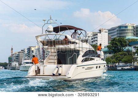 Male, Maldives - November 17, 2017:  Speed Boat Docking To Pick Up Tourists On The Island Of Male, M