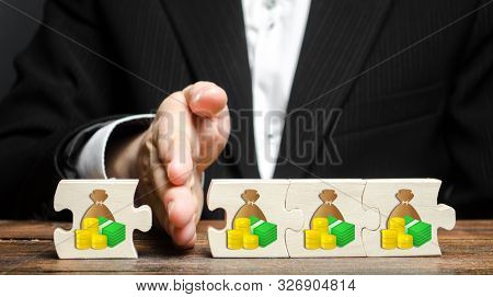 A Businessman Separates Part Of The Money From The Total. Payment Of Taxes And Deductions. Corruptio