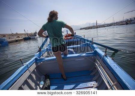 Skipper Rowing On The Sea On A Rowing Boat