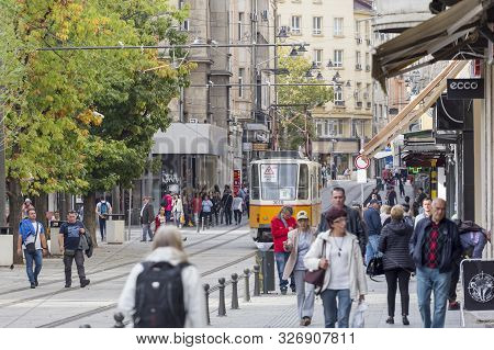 Sofia, Bulgaria - Oct 10: Pedestrians And Trams Are Passing Through The Renovated
