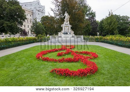Mozart Statue With Flower Decoration In The Form Of A Musical Treble Clef Key, Vienna, Austria
