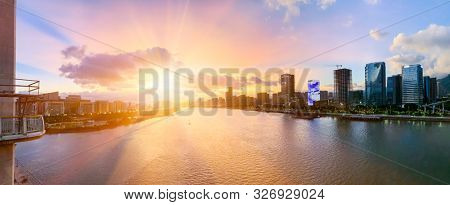 Aerial panoramic cityscape view of Fuzhou and the River Min at sunset,Fujian,China