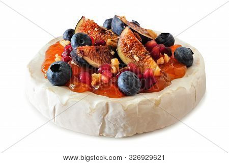 Baked Brie Appetizer Topped With Figs And Jam, Blueberries, Pomegranates And Nuts. Side View Isolate