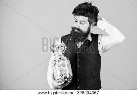 poster of What is a good way of investing money. Bearded man thinking of investing money into business. Businessman calculating his future cash flow from investing activities. Investing in future, copy space